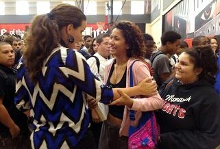 Cara greets students following the presentation.